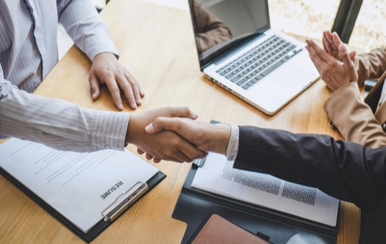 shaking hands for business agreement